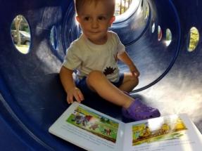 Yoshi enjoys a book